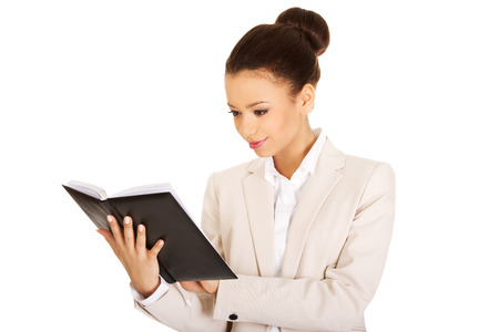 african american woman business: African businesswoman with a notebook.