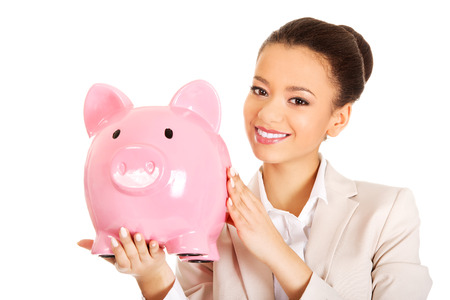 coinbank: African business woman with a piggybank. Stock Photo