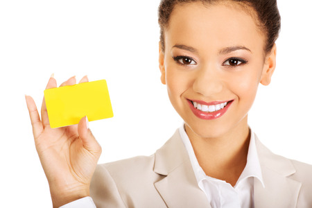 businesswoman card: African businesswoman holding a card. Stock Photo
