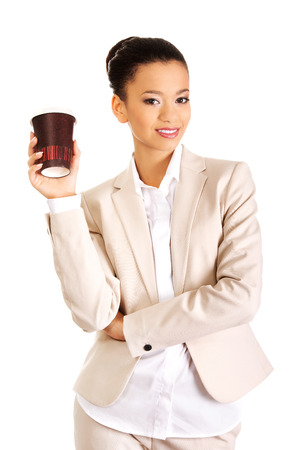 african american woman business: Smiling businesswoman with coffee cup.