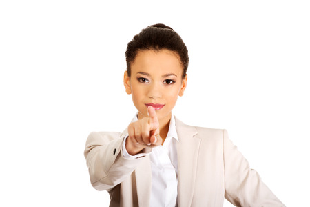 Happy african businesswoman pointing on you. photo