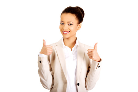 happy businesswoman: African businesswoman showing thumbs up. Stock Photo