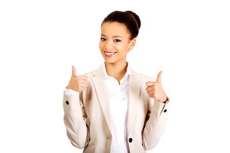 carita feliz: �frica negocios que muestran los pulgares para arriba. Foto de archivo