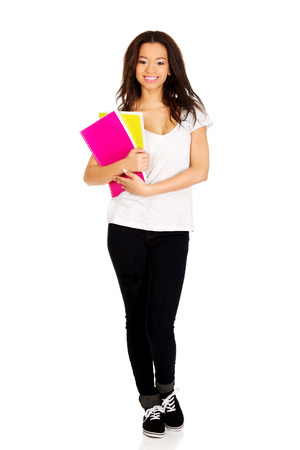 african student: Young african student woman with notes. Stock Photo