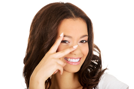 Happy african teenager woman showing victory sign photo