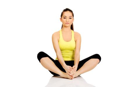 warm up: Giovane donna di forma fisica nel warm up esercizio. Archivio Fotografico