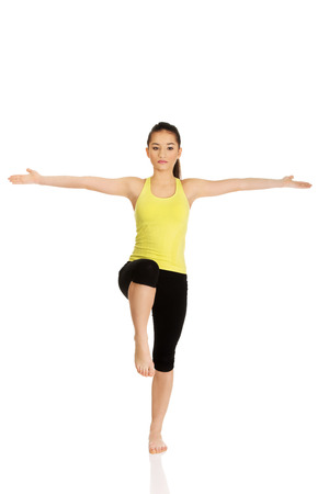 arms wide open: Young fitness woman with arms wide open. Stock Photo