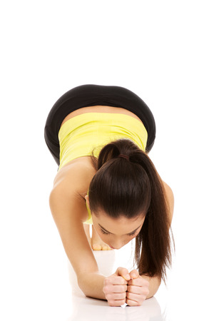 warm up: Young fitness woman in warm up exercise.