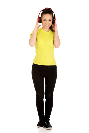 Young teenage woman with headphones listening to music. photo