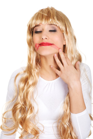 smeared mascara: Sad blonde woman with smeared red lipstick.