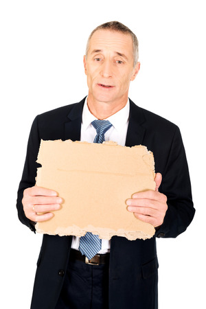 Mature businessman with a piece of cardboard photo