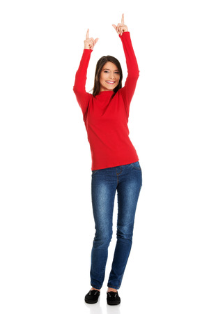 pointing up: Beautiful student woman pointing up. Stock Photo