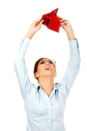 Unhappy businesswoman holding empty purse. photo