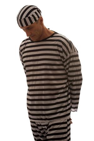 Mature sad man prisoner in striped clothes. photo