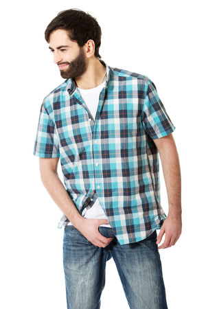 crotch: Young man holding his crotch because of pain. Stock Photo