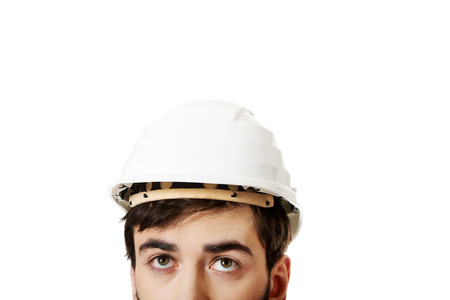 foreman: Young handsome foreman with hard hat looking up.