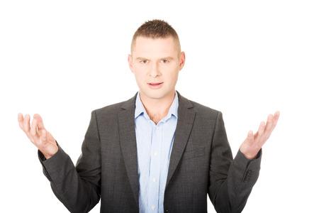manos abiertas: Joven hombre de negocios frustrado con las manos abiertas
