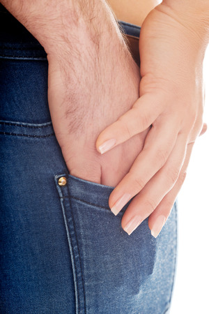 man ass: Male hand in beautiful womans jeans pocket.