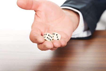 double game: Businessmans hand with two dices. Stock Photo
