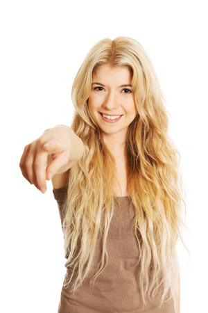 Happy teenager woman pointing on you. photo