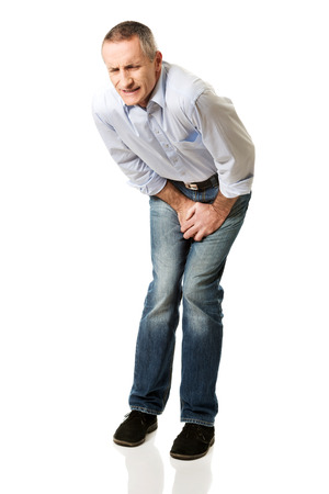 crotch: Embarassed man covering his painful crotch