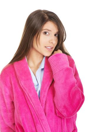 woman bathrobe: Beautiful caucasian woman wearing pink bathrobe.