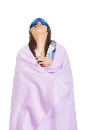 coverlet: Morning woman wrapped in coverlet wearing eyes band. Stock Photo