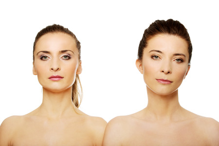 topless women: Two attractive topless sisters with make up.