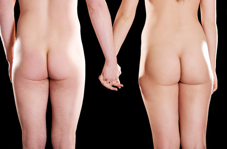 nude female buttocks: Young naked couple holding their hands together.