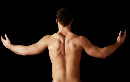 homme nu: Sexy homme muscl� nu montrant son dos muscl�. Banque d'images