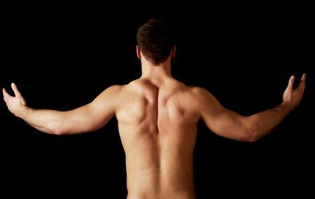 uomo nudo: Sexy uomo muscoloso nudo, mostrando la schiena muscolosa.