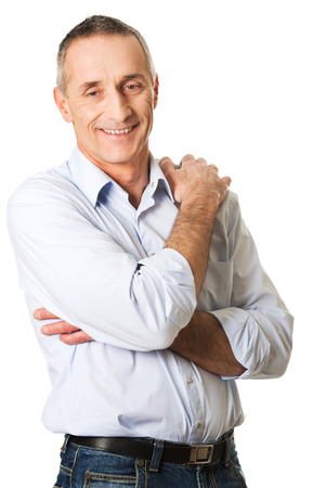 folded arms: Smiling mature man with folded arms