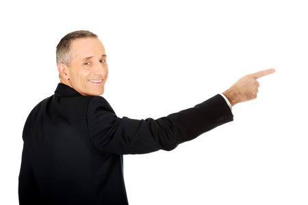 back view: Back view businessman pointing right. Stock Photo