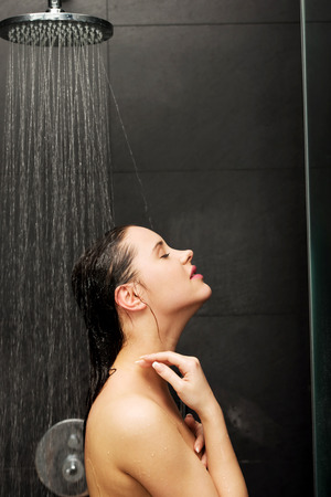 Beautiful woman standing at the shower.