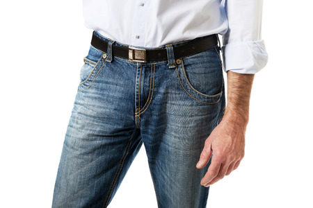 unrecognisable people: Fashionable mature men in jeans trousers.