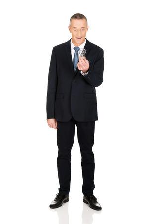 full length: Full length shocked businessman with light bulb. Stock Photo
