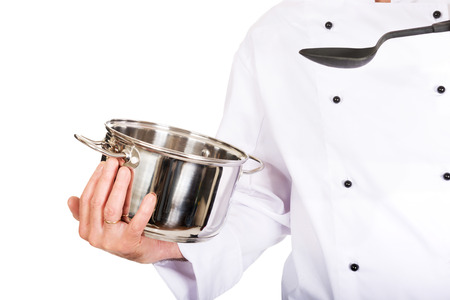 stockpot: Restaurant chefs hand holding steel pot and spoon