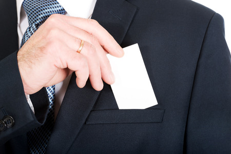cardkey: Mature businessman taking a blank card from pocket. Stock Photo