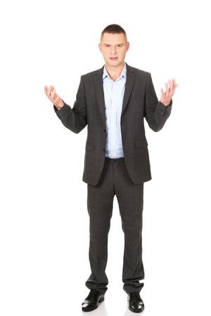 mains ouvertes: Frustr� jeune homme d'affaires avec les mains ouvertes