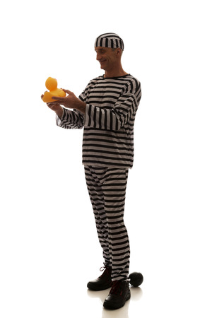 Mature sad man prisoner criminal with rubber duck. photo