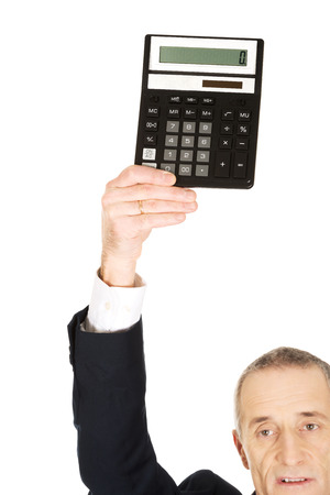 Businessman holding a calculator above his head. photo