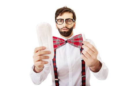 menstruation: Handsome man wearing suspenders with menstruation pad.