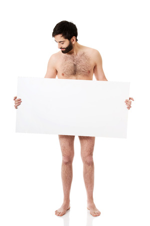naked people: Young handsome shirtless man holding empty banner.