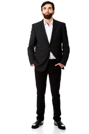 hands on pockets: Handsome pensive businessman with hands in pockets. Stock Photo