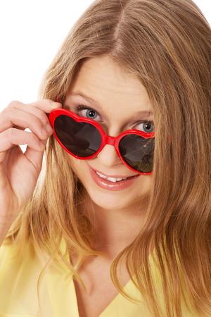 Young teenage woman wearing sunglasses photo