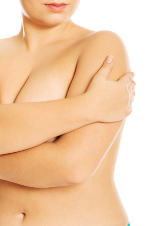 Overweight woman covering her breast photo