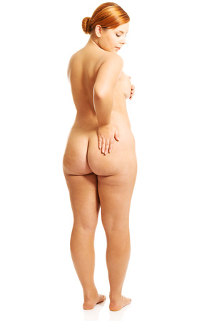 Overweight woman touching her buttock Stock Photo