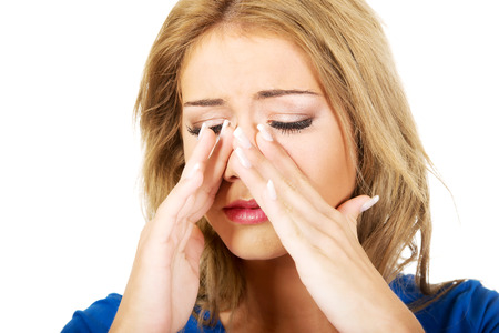 complications: Beautiful young woman with sinus pressure pain.