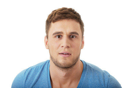 shoked: Handsome shoked man looking at camera. Stock Photo