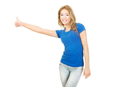 Young unhappy woman with thumbs down. photo